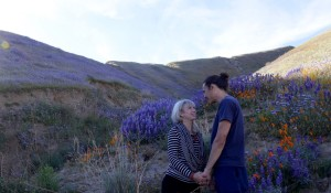 Anji and Ryan sharing a moment in a lupine field