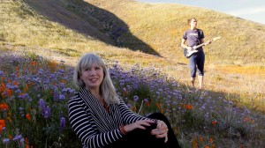 Anji and Ryan in a field of wildflowers